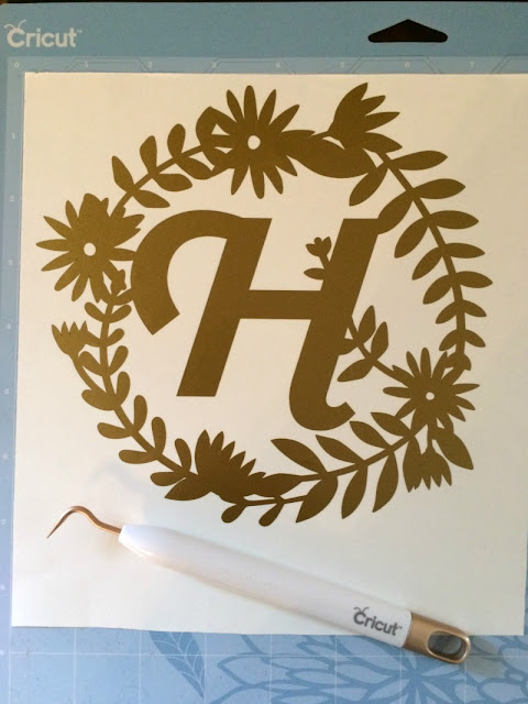 Make an easy monogrammed canvas wall art using your Cricut Explore.