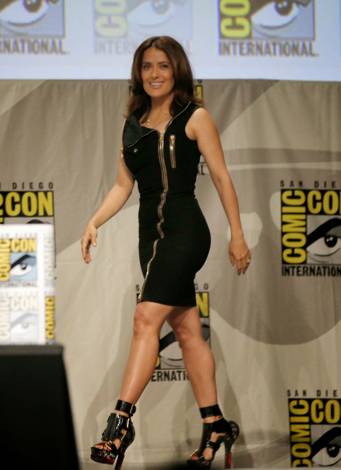 Salma Hayek promotes 'Everly' in a figure hugging black mini dress at Comic-Con 2014
