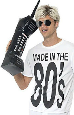 Guy holding an 80s inflatable brick phone