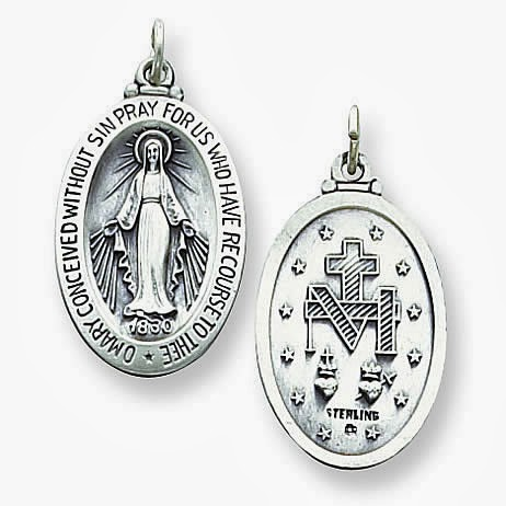 Two images of the Miraculous Medal, back and front.