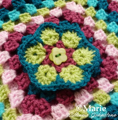 Colorful crochet granny square and flower design