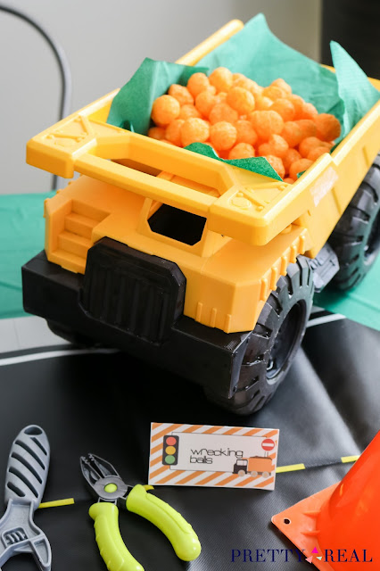 dump truck used to hold snacks at an easy non DIY construction themed birthday party