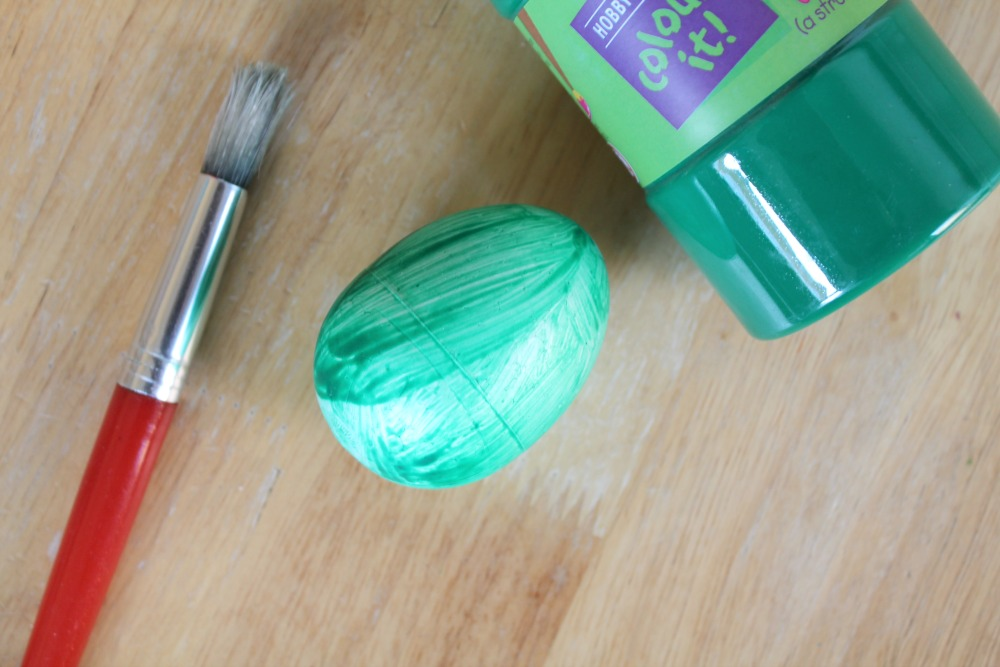 craft-egg-painted-green-with-brush-and-paint