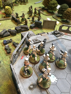 Rebels take fire from Stormtroopers on the landing pad