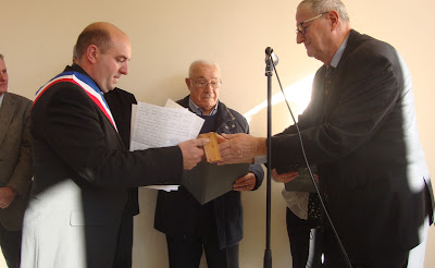 Current mayor of Ceyroux, Ludovic Daquet,  accepting the medal for his grandfather, Leon Daquet  Mr. Simonnet against the wall receiving medal