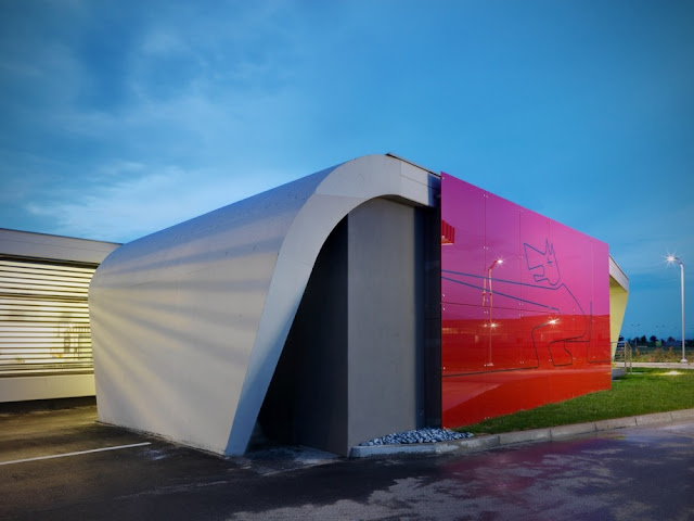 Red detail on the facade of Gazoline Petrol Station by Damilano Studio Architects