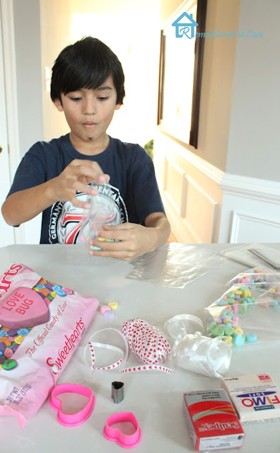 Boy setting up Valentine treats