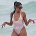 Former Atlanta House wife star Claudia Jordan goes to the beach in see-through swimwear