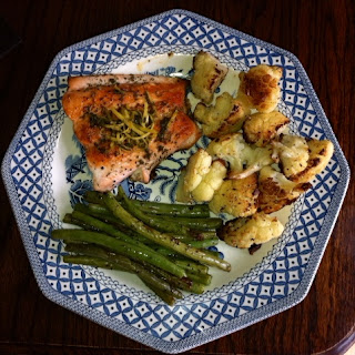 Salmon with roasted cauliflower and green beans on a plate