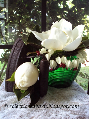 Eclectic Red Barn: Magnolia Blooms in Green Vase with Antique Iron
