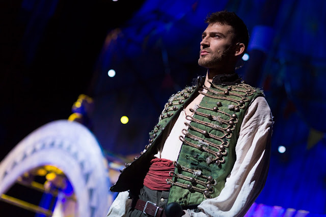 jake quickenden as peter pan, in white shirt and green waistcoat