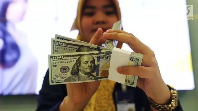 Dolar AS Melemah, Investor Menunggu Kepastian Reformasi Pajak