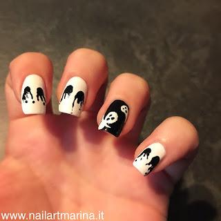 Unghie halloween con fantasma e occhi lacrimanti neri