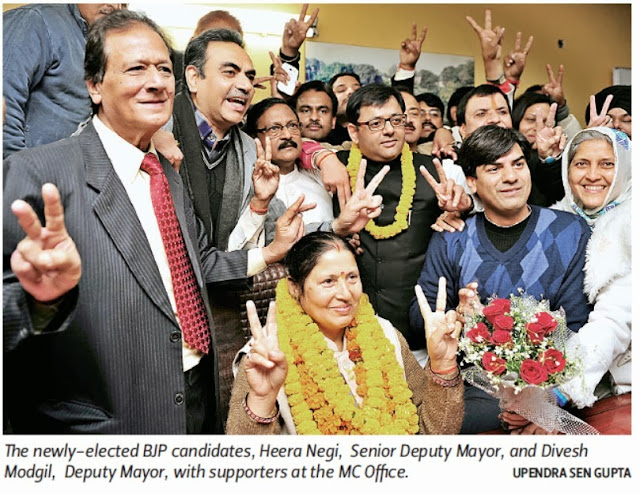 The newly - elected BJP candidates, Heera Negi, Senior Deputy Mayor, and Davesh Moudgil, Deputy Mayor, with Ex-MP Satya Pal Jain and others at the MC Office