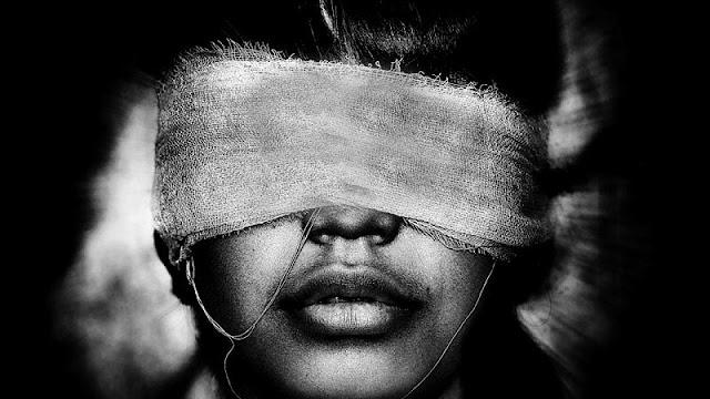 girl wearing eye mask to demonstrate as blind