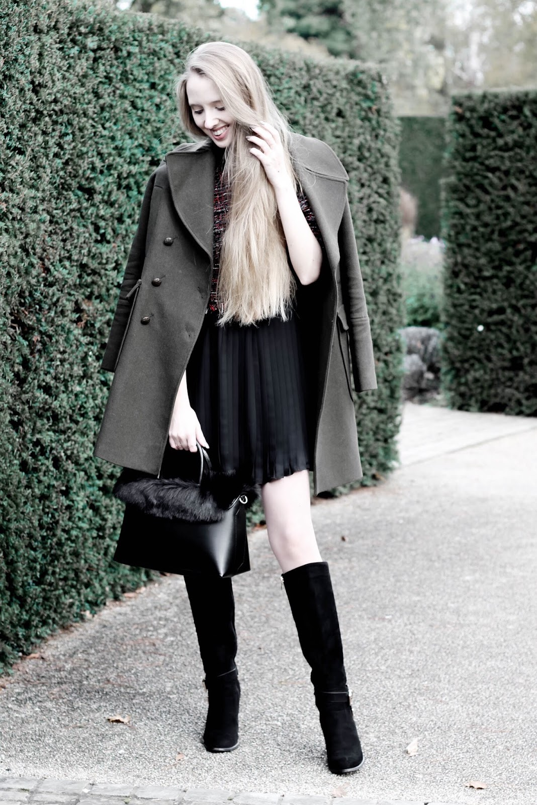 Fashion blogger styling khaki wool coat in winter