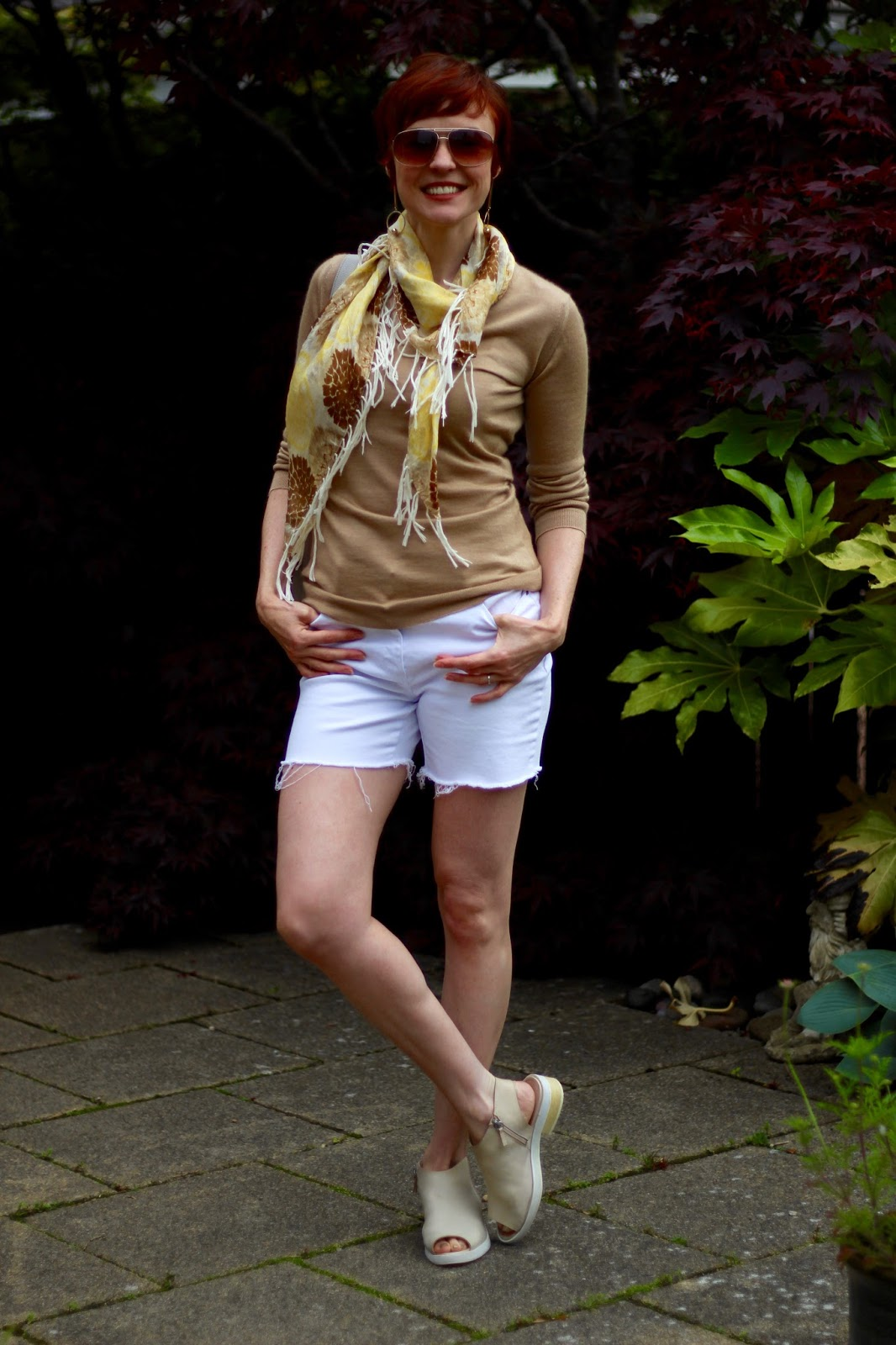 White Denim Cut-offs, Camel cashmere v-neck, yellow silk scarf, nude mules, over 40. | FakeFabulous