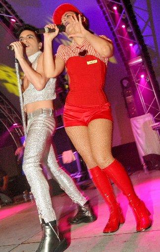 Foto de Miranda cantando en concierto