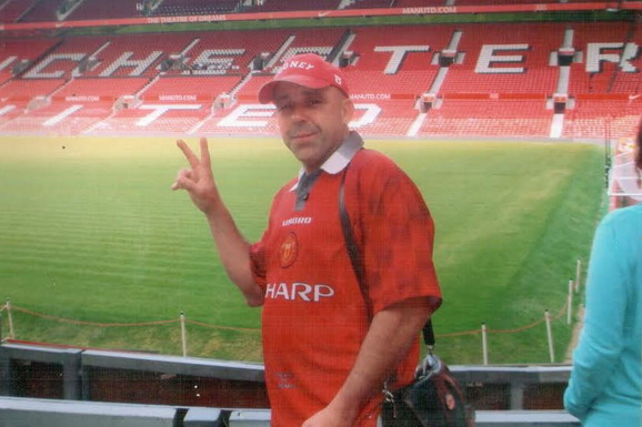 Hardcore Manchester United fan Marin Zdravkov poses whilst visiting Old Trafford