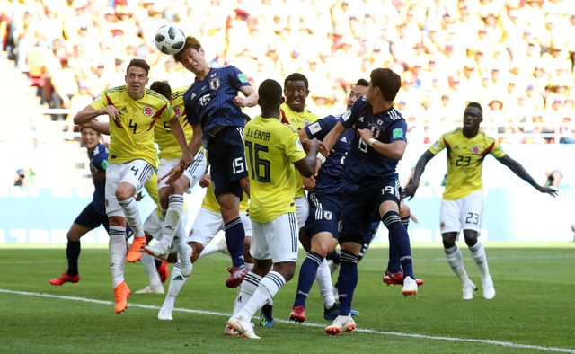 Japan's Yuya Osako scores their second goal against Colombia