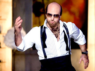 Tom Cruise as foul-mouthed, hot-headed, half-bald studio executive in Tropic Thunder, Directed by Ben Stiller