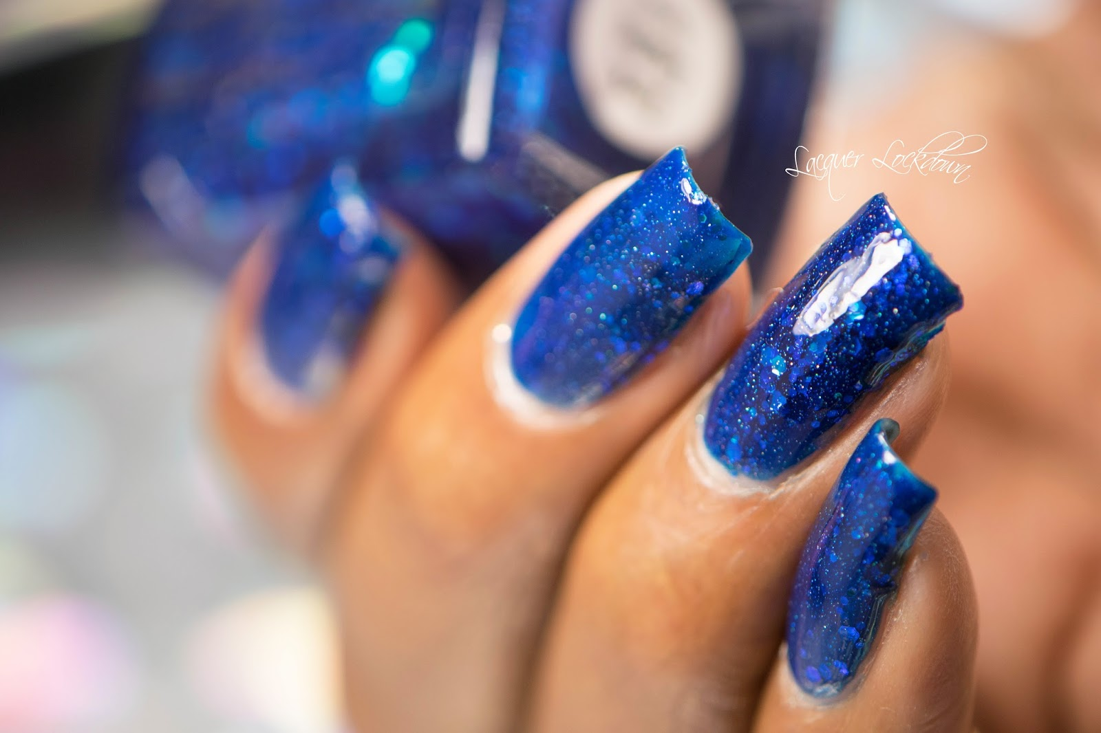 Lacquer lockdown holographic wildflowers swirls nail art tutorial as you shift your nails around you can see all the glitter sinking and swimming inside the blue jelly its also has these tiny little sparkles throughout prinsesfo Image collections