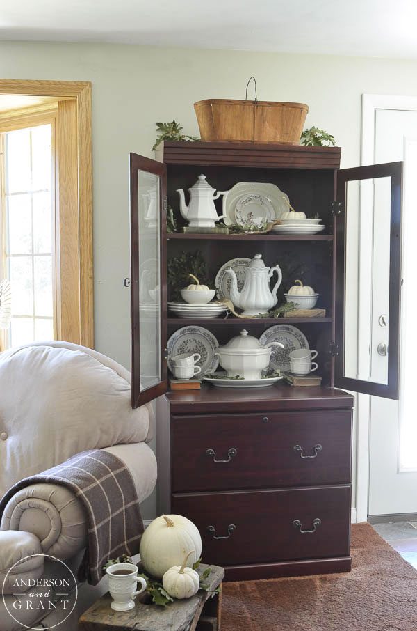 Hutch filled with a collection of ironstone for fall.  |  www.andersonandgrant.com