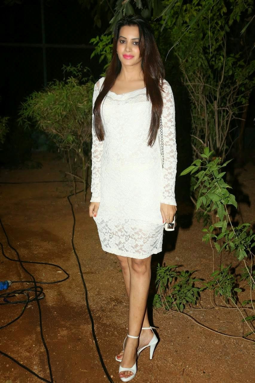 Actress Diksha Panth Latest Audio Launch Stills, Actress Diksha Panth Crossleg Sitting Pics in White Dress from Event