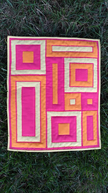 Modern mini quilt using Kona solids, Aurifil thread, Hobbs Batting, and reverse applique