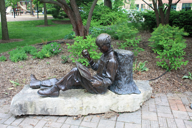 Boy reading statue Northrbook