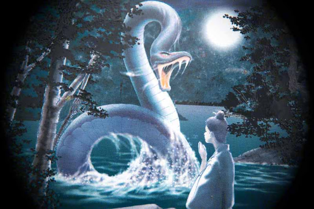 Image of a serpent and virgin girl, praying, full moon