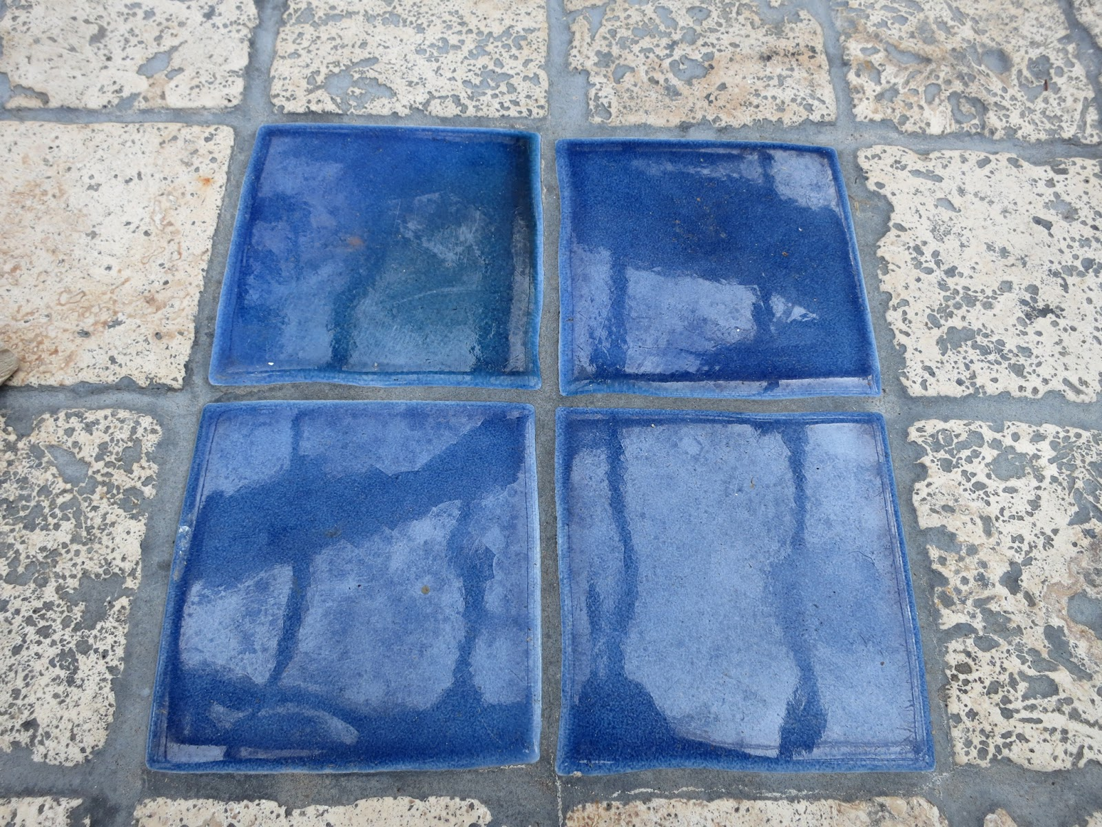 Blue squares. Grey lines. Tiled table top.