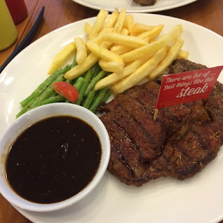 Australian Rib Eye by Holycow with black pepper sauce and french fries