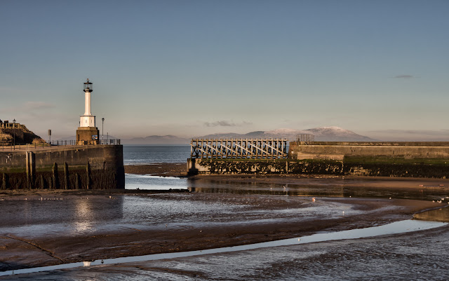 Photo of Maryport lighthouse at low tide