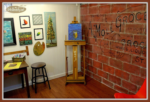 VIntage Advertising ghost wall painted on old cinder block basement wall, diy art studio, before and after makeover brick