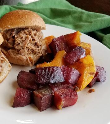roasted veggies on plate with pulled pork sliders