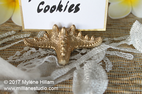 Gold painted resin starfish food label holder