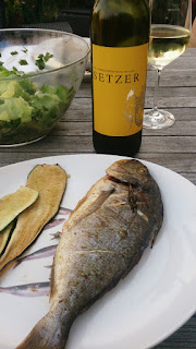 A wine from Austria of the Roter Veltliner grape paired with a grilled gilthead