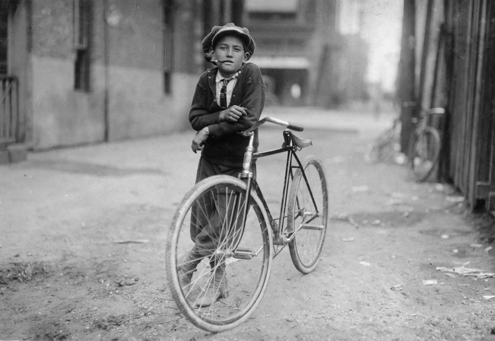 A pipe-smoking messenger boy working for Mackay Telegraph Company. He said he was fifteen years old. Photographed in Waco, Texas in September of 1913.