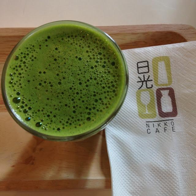 a glass of green matcha tea
