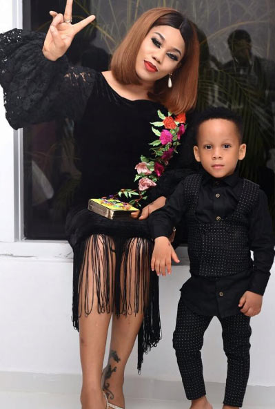 Toyin Lawani and her son rock matching colors for Future Awards