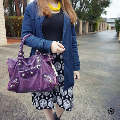 awayfromblue instagram black knit dress for the office with colourful accessories purple Balenciaga bag statement necklace