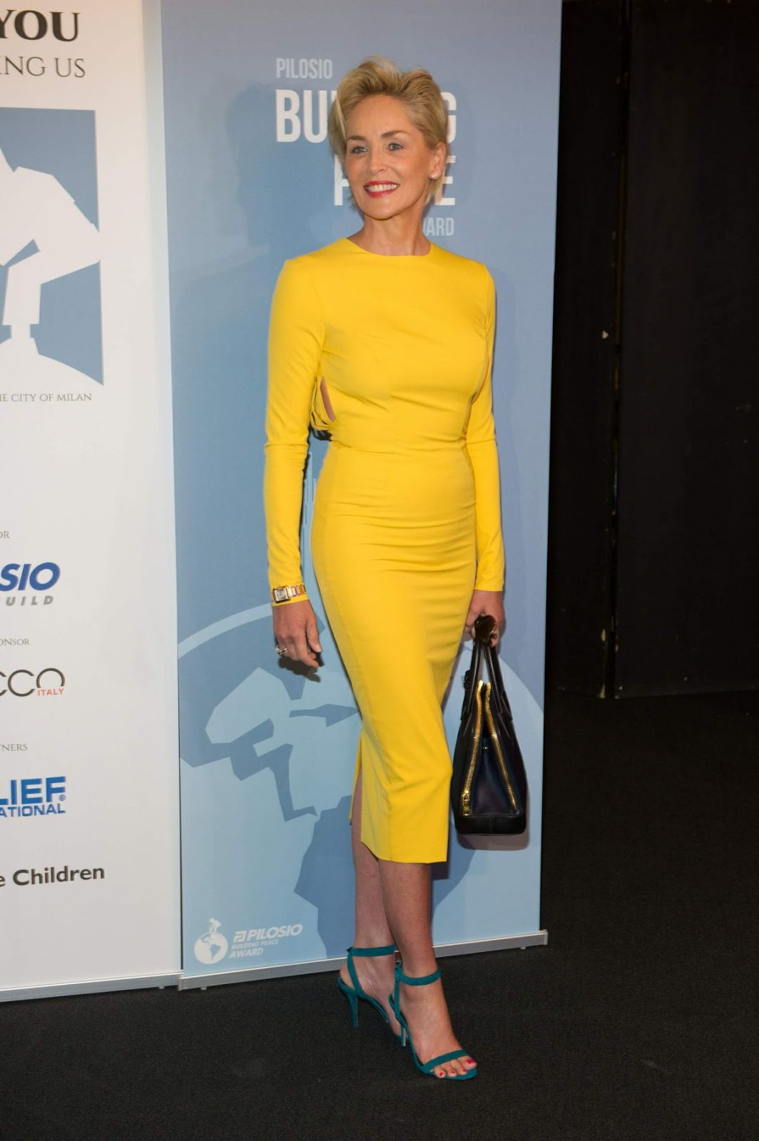 HQ Photos of Sharon Stone in Yellow dress At Pilosio Building Peace Award 2015 In Milan