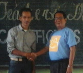 The PTA President and the School Principal shaking hands.
