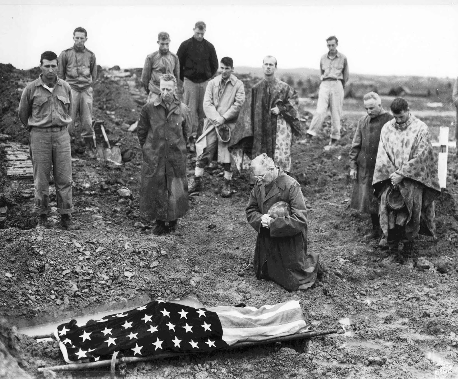 US Marine Colonel Francis Fenton conducting the funeral of his son Private First Class Mike Fenton, near Shuri, Okinawa, May 1945.
