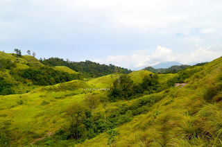 Lereng-lereng hijau di seberang Bukit Pulisan, Likupang Timur, Minahasa Utara, Sulawesi Utara +jelajahsuwanto