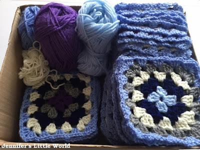 Box of crochet granny squares