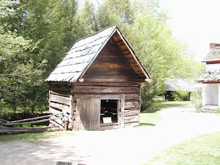 This is a smokehouse, where meat was cured and stored.