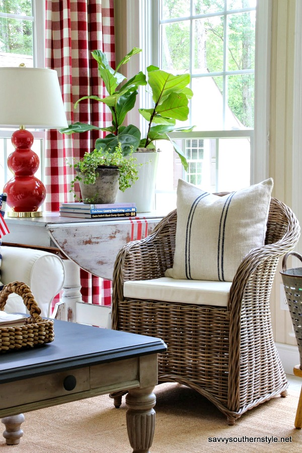 Breezy style with red, white, and blue Americana palette in a southern sun room decorated for summer. #traditional #sunroom #redwhiteblue #americana #summerstyle #gingham #homedecor #patriotic