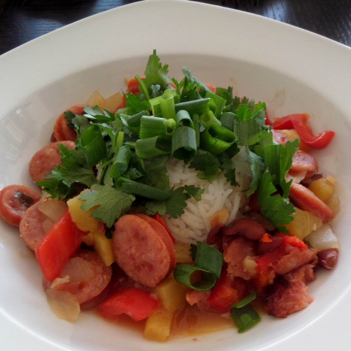 Sausage and Bean Sweet and Sour:  Pineapple sausage and beans in a spicy sweet and sour sauce served over rice.